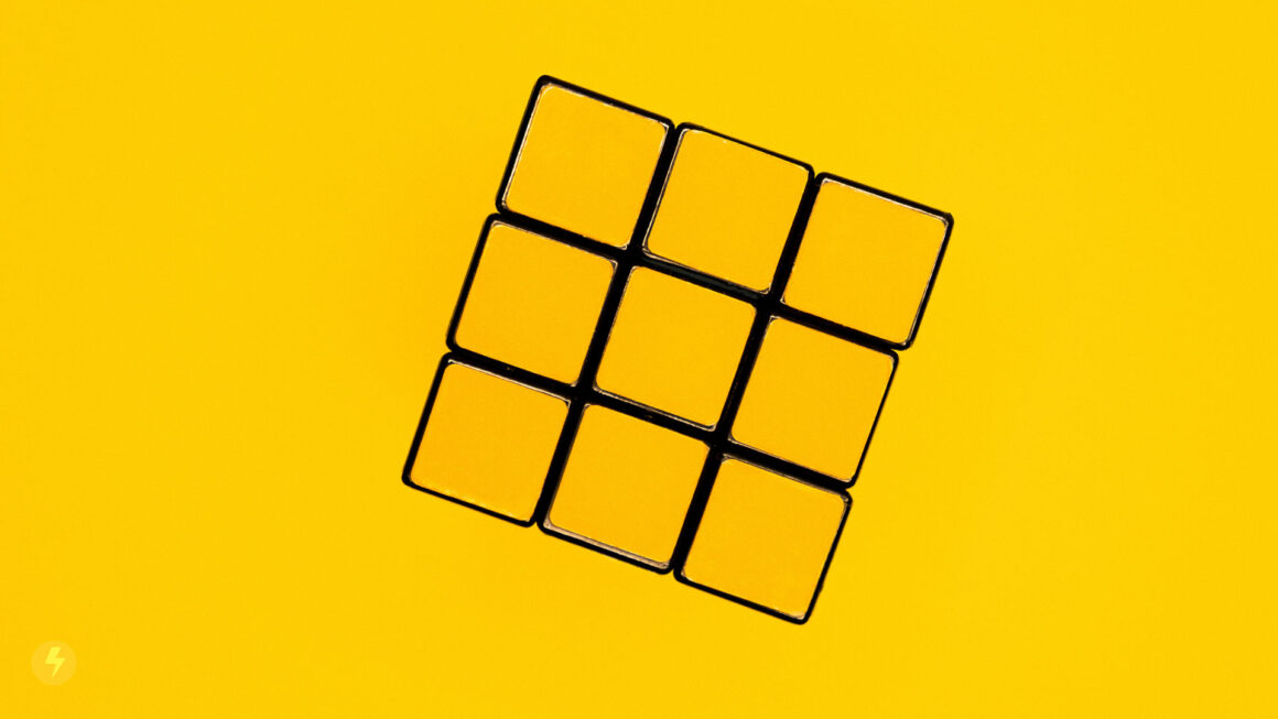 rubiks-cube-on-yellow-background-wakilisha.africa-design-thinking-solutions
