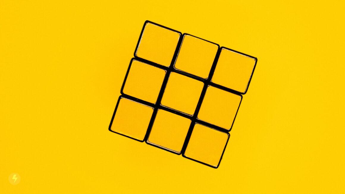 rubiks-cube-on-yellow-background-wakilisha.africa-design-thinking-solutions
