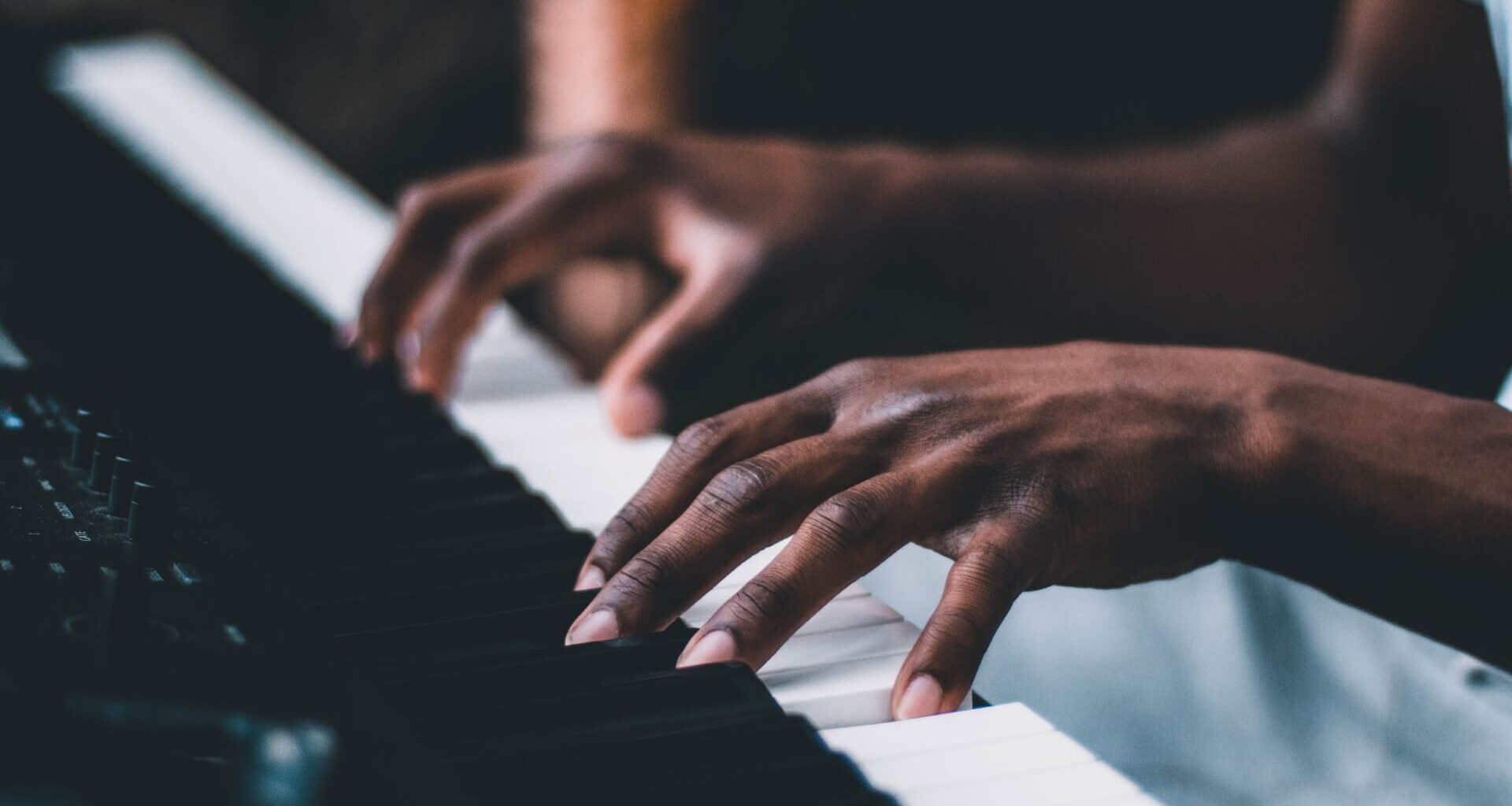 Young african man playing the piano | Why Is Music Important?